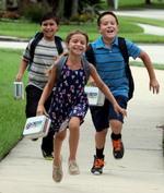 RUNNING CHILDREN W LUNCHBOXES